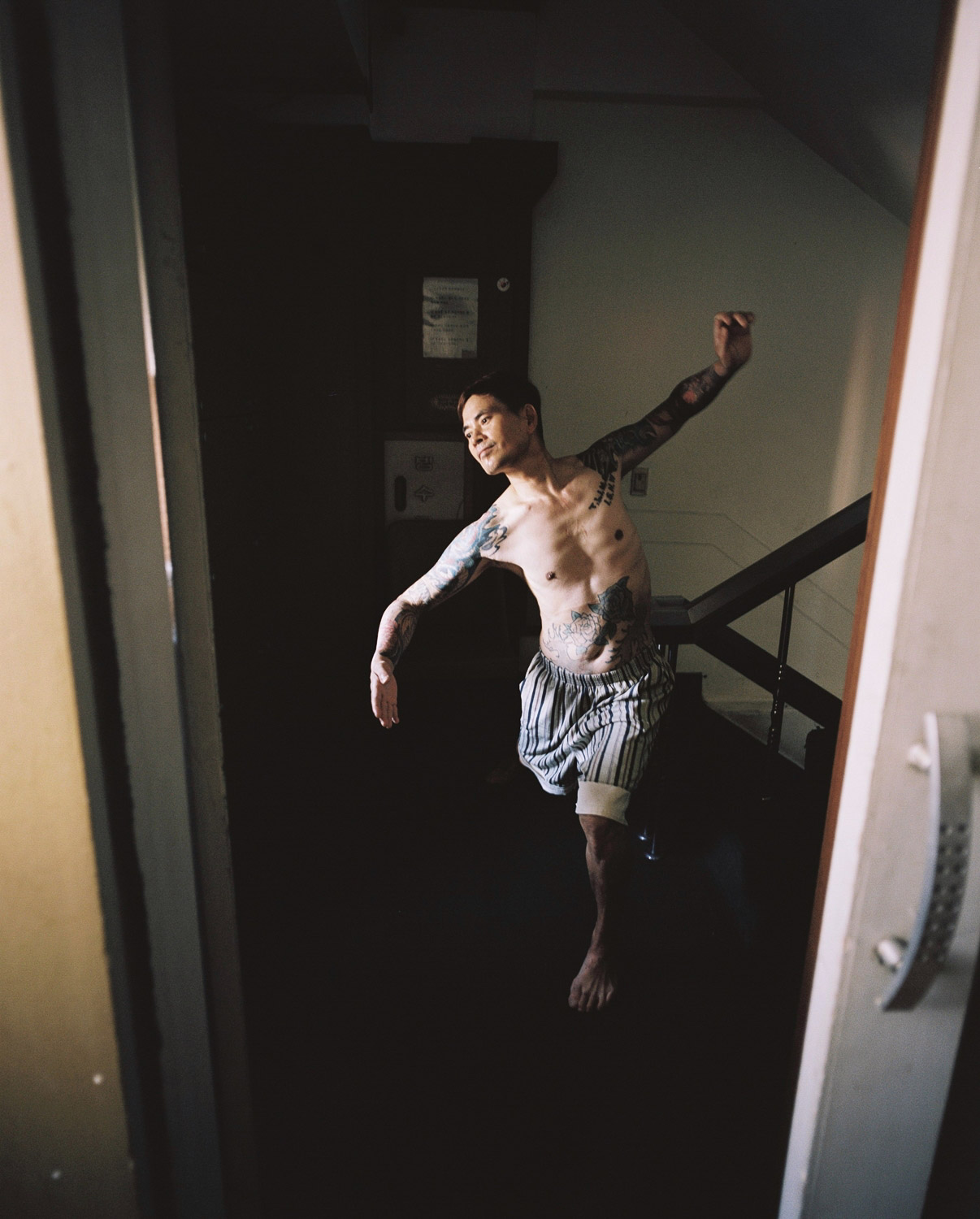 A resident looks into a mirror in the stairway. and practices sports dance. (Credit: Sim Kyu-dong)