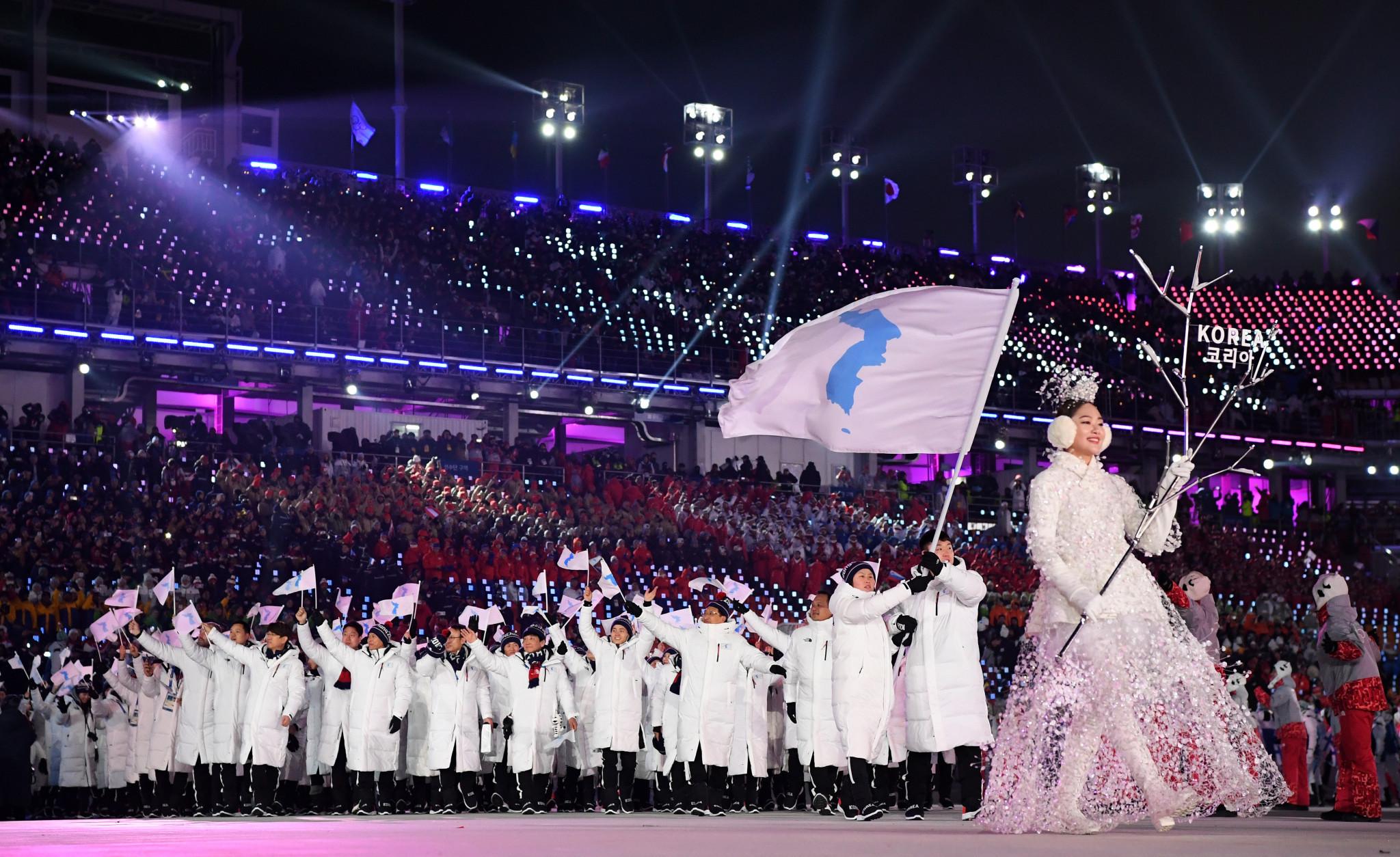 Entrada Das Delegações Coreanas Unidas Sob A Bandeira Da Coreia Unificada. Foto: Inside The Games