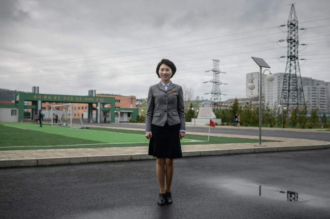 In a photo taken on May 14, 2018 student and former Korean People's Army (KPA) soldier Ma Song Hui (26) poses for a portrait outside the Pyongyang Teacher Training College where she studies, in Pyongyang. / AFP PHOTO / Ed JONES/2018-07-31 15:20:18/