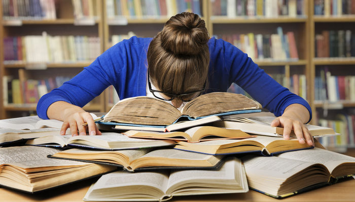thumb_young-woman-studying-library